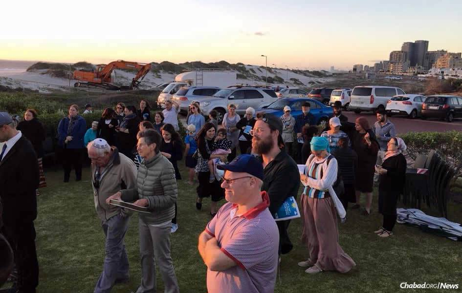 Jewish community members in Cape Town, South Africa, gather to pray as the city faces the imminent prospect of completely running out of water.