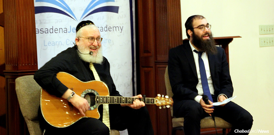 """The first of five events for a new program called """"Torah Through the Arts,"""" developed in California by Rabbi Zushi Rivkin, right, featured musician and songwriter Rabbi Chaim Fogelman, who performed for the audience and offered Torah inspirations related to the music."""