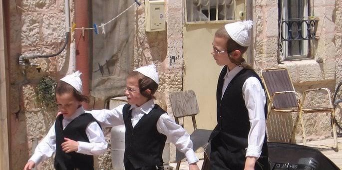 Boys in Jerusalem wearing the traditional white knitted yarmulke (photo: Yoav Elad)