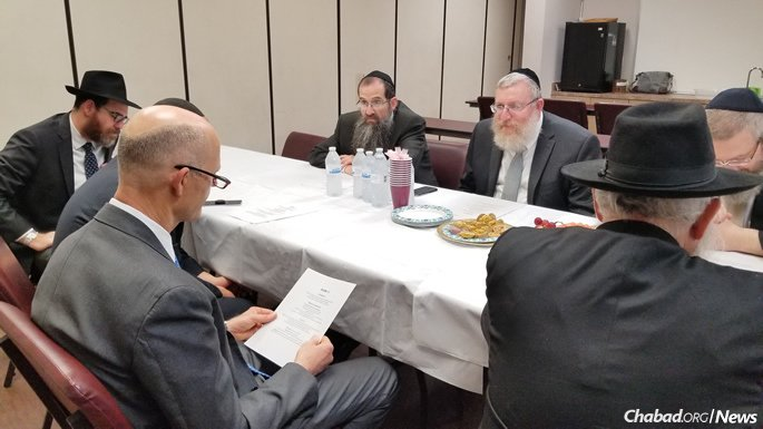 The governor listens as Rabbi Yossie Denburg offers proposals for increased moral education and student community-building in the public-school system.