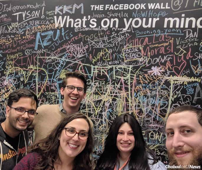 Tech Tribe directors Chana and Mordechai Lightstone, far right, at Facebook's New York offices.