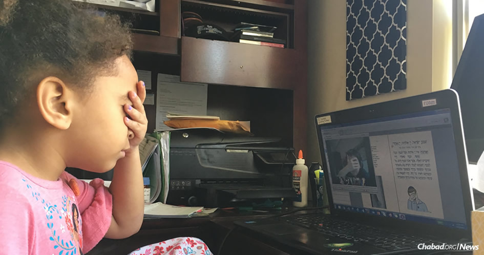 Bethany Conner learns to say the Shema prayer at the Nigri Jewish Online School with the help of her fellow students and teacher.
