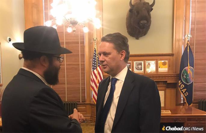 Rabbi Zalman Tiechtel with Kansas Gov. Jeff Colyer.