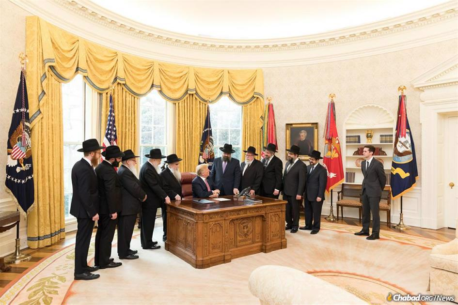 The rabbis who met with President Donald Trump on Education and Sharing Day, 2018. (L. to R) Rabbis Mendel Alperowitz, Isser New, Yisroel Shmotkin, Moshe Herson, Avraham Shemtov, President Donald Trump, Levi Shemtov, Zalman Levertov, Yehoshua Harlig, Levi Klein, Zalman Grossbaum, and Avraham Berkowitz, special assistant to the President. (White House Photo: Andrea Hanks)