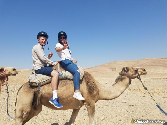 Julian Reiss, 21, left, with a travel guide during a tour of Israel with Friendship Circle.