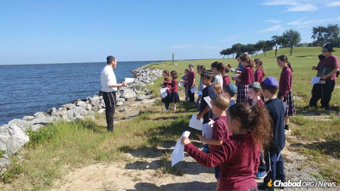Facing the Gulf of Mexico, Torah Academy students perform Tashlich, the symbolic casting of sins into the water's depths in the week between Rosh Hashanah and Yom Kippur.