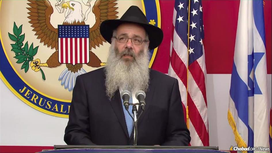 Rabbi Zalman Wolowik, co-director of Chabad of the Five Towns in Cedarhurst, N.Y., and a longtime friend and Torah-study partner of U.S. Ambassador to Israel David Friedman, delivers the invocation at the historic opening of the U.S. Embassy in Jerusalem.