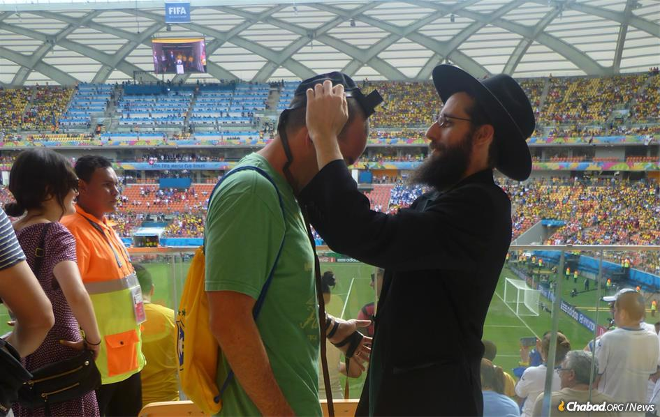 Among the thousands of Jewish fans traveling to the World Cup will be many Westerners and Israelis who have never been to Russia. Chabad centers around the country are preparing to welcome them and encourage them to explore all aspects of Jewish life, as Chabad representatives did four years ago at the World Cup games in Brazil, above. (File Photo)