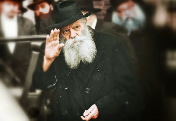 "The Rebbe waves before getting into a waiting car, Monday, 27 Adar I, 5752 (March 2, 1992), less than two weeks after distributing the ""Ve'atah Tetzaveh"" discourse to men, women and children."