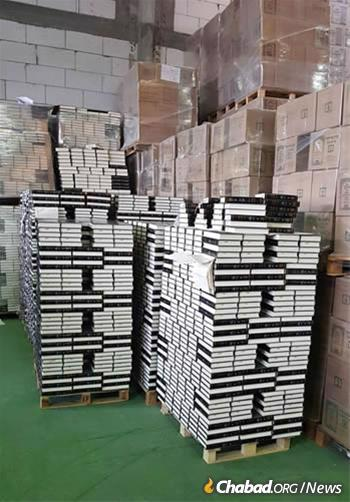In the past year, 330,000 volumes of Toras Menachem, encompassing the Rebbe's farbrengens from 1950 until the summer of 1970, were shipped to buyers worldwide. At a point, no Israeli printing house carried enough paper to fulfill the order; supplies had to be boated in from England. (Photo: Lahak)