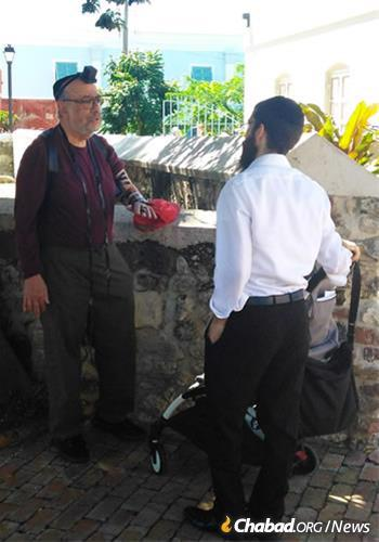 The rabbi helps a visitor with a mitzvah on the go.