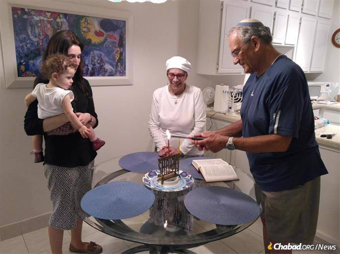 Eric and Penny Bowman enjoy a menorah-lighting and Chanukah celebration with the Chaikin family.