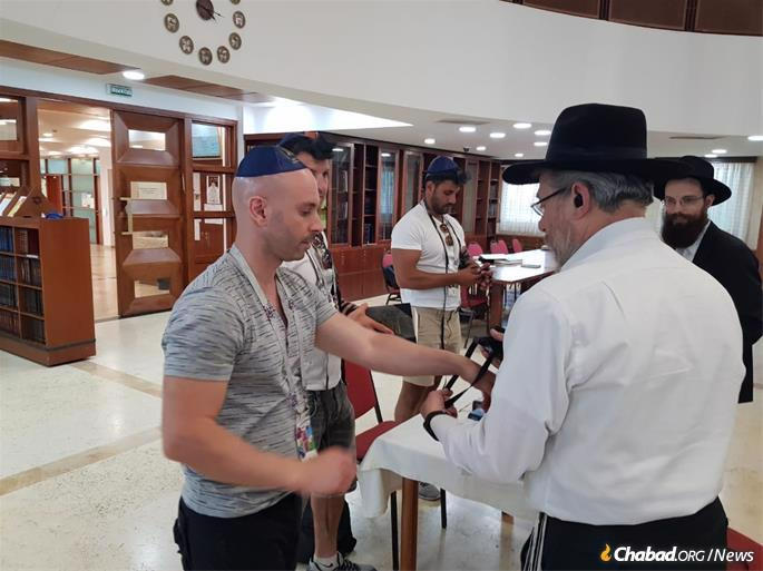 Chabad emissaries in Moscow assist visitors with tefillin and other Jewish needs.