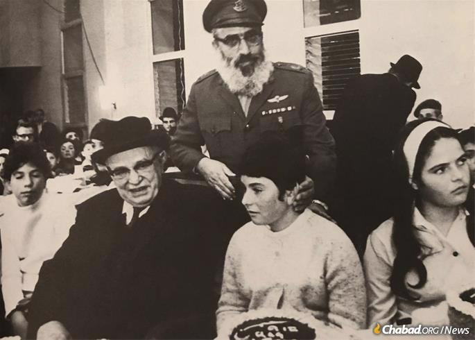 Israel's President Zalman Shazar, seated, and Rabbi Shlomo Goren, the first chief rabbi of the Israel Defense Forces, at a ceremony for the daughters of fallen soldiers.