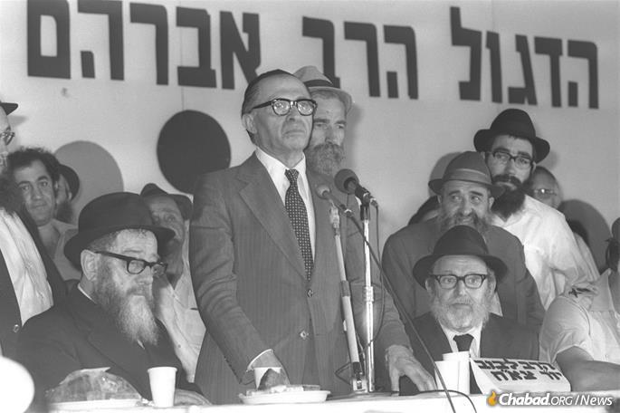 Israeli Prime Minister Menachem Begin addresses a bar mitzvah ceremony for the sons of fallen soldiers in Kfar Chabad, 1977.