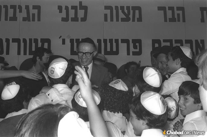 Begin surrounded by war orphans at a special bar mitzvah ceremony in their honor. (Photo: Moshe Milner)