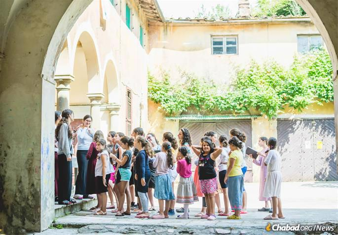 Morning lineup in the ancient sun-baked courtyard. (Photo: Batsheva Helena Goldreich for Chabad.org)