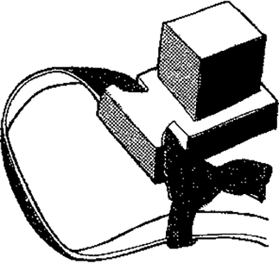 """Fig. 12: The """"house"""" (bayis) of the tefillin of the arm (tefillin shel yad). The knot (kesher) at the end of the strap (retzuah) that passes through the protruding edge (maabarta) of the base (titura) has not yet been drawn into position against the cube (ketzitzah) which contains the inscribed parchment scroll (parshah)."""