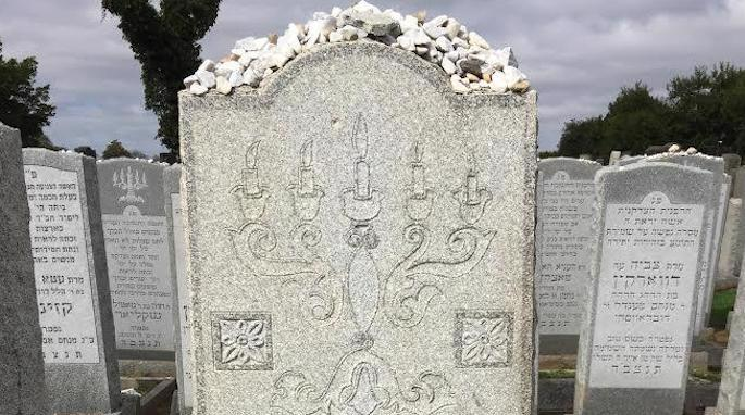 The candelabra marks the grave of a pious Jewish woman.