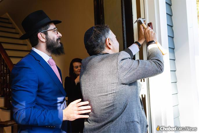Affixing the mezuzah (Photo: Chabad of Dartmouth)