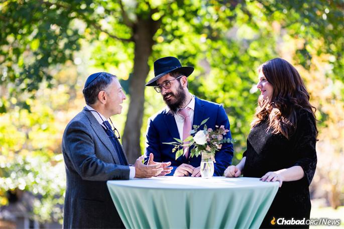 Philanthropist George Rohr, left, with Rabbi Moshe and Chani Gray, co-directors of Chabad at Dartmouth. (Photo: Chabad of Dartmouth)
