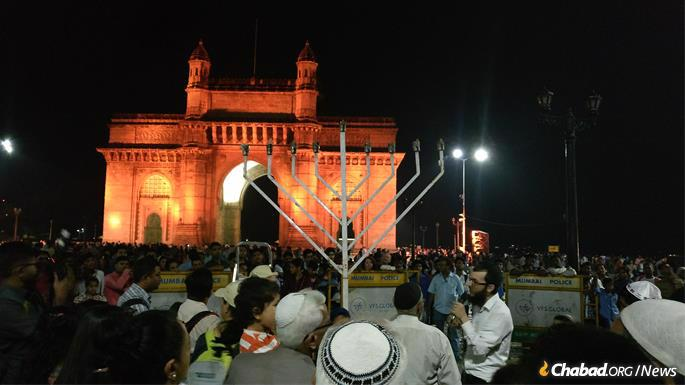 Rabbi Yisroel Kozlovsky prepares to light a menorah at the Gateway of India. He and his wife, Chaya, have run the Chabad House in Mumbai for the past five years. (Photo: Bombay Arthouse/Chabad.org)