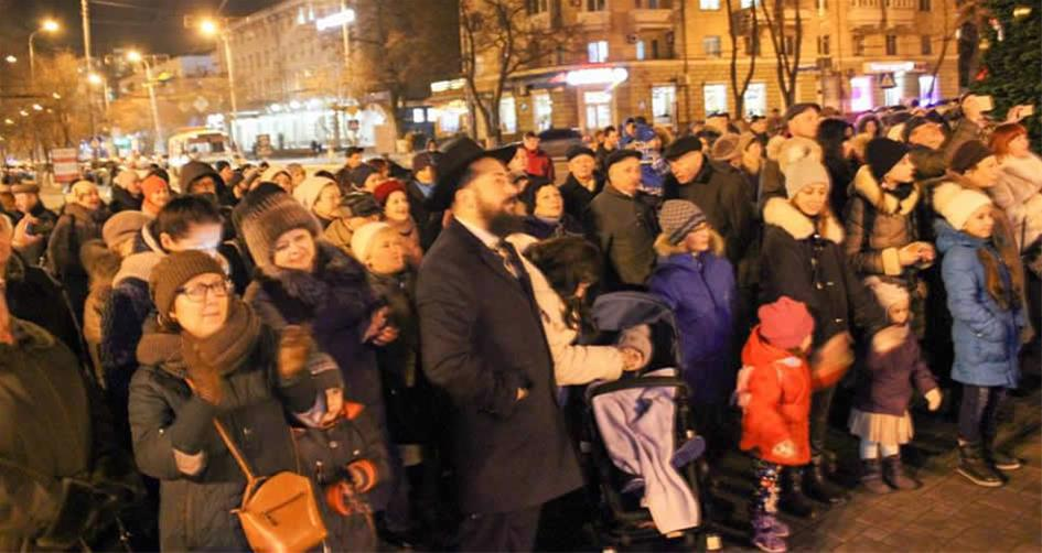 Despite the government's declaration of martial law, a public celebration of Chanukah will take place, as pictured above last year in the Ukrainian frontline city of Mariupol.