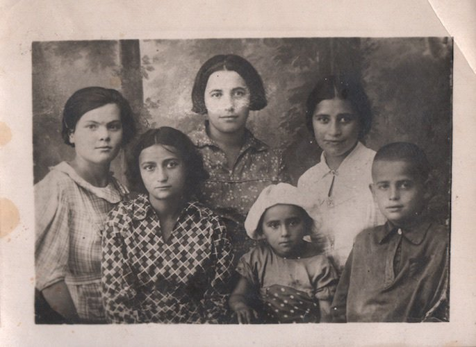 L-R: Luba Pinson, the author Shifra on top right, her sister Luba on bottom left, and next to her is baby Chaya. Older girl in center top and boy at the bottom right are neighbors.