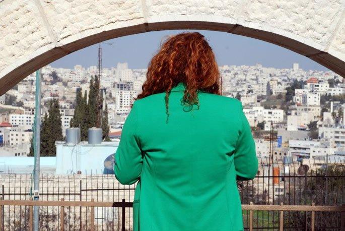 Praying at Rebbetzin Menucha Rochel's gravesite, overlooking Hebron.