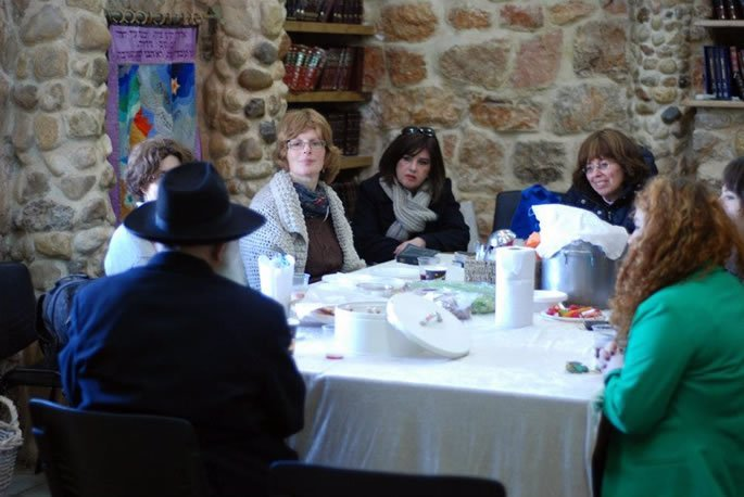 Women study at Colel Menucha Rochel, a yeshivah established at the gravesite.