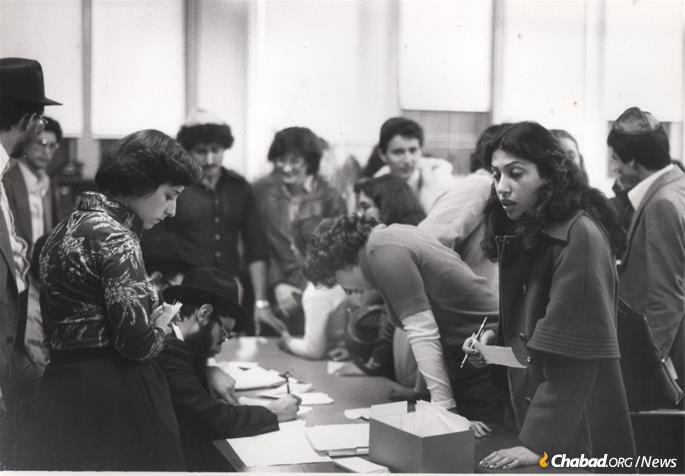 Chabad's campaign to bring 1,800 Iranian children to safety lasted between the end of 1978 and late summer of 1980. Pictured is one of the groups going through registration upon arrival in the Crown Heights neighborhood of Brooklyn, N.Y., circa 1979. (Photo: Courtesy NCFJE)