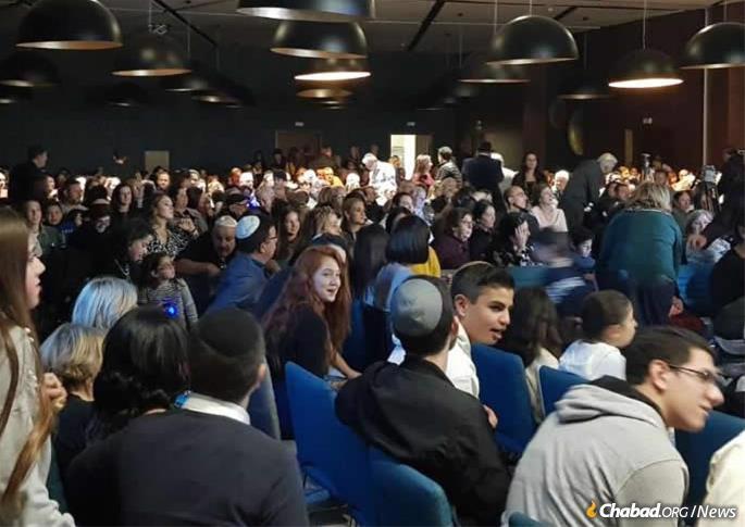 Hundreds attend a Chanukah menorah-lighting and event.