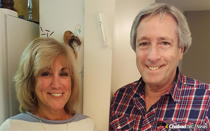 Michael and Maureen Nelson get kosher mezuzahs on all doors in their home.