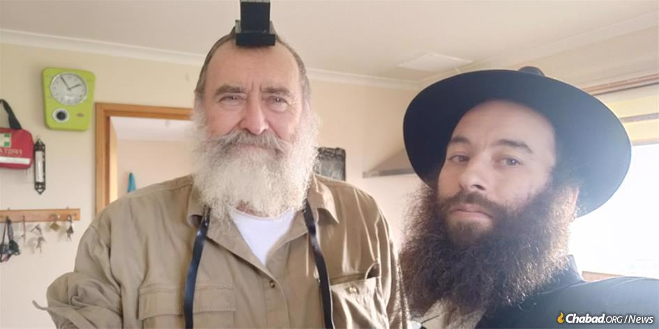 Paul Williamson, left, who runs the Flinders Island Distillery, with Rabbi Yochanan Gordon