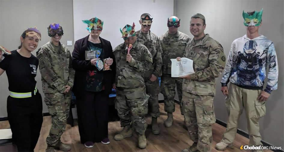 Capt. Sanford Cohen, second from right, held a Purim celebration in March at a U.S. Army base in Kuwait. This week, he will host a Passover seder.
