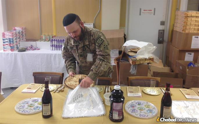 Capt. Mendy Stern, chaplain for the 312th Military Intelligence Battalion, sets up for a Passover seder.