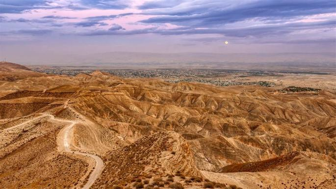"""Long ago, Greek/Roman historian Strabo described Jericho as """"surrounded by a kind of mountainous country…it consists mostly of palm trees."""" Little has changed in this little town in the Judean desert."""