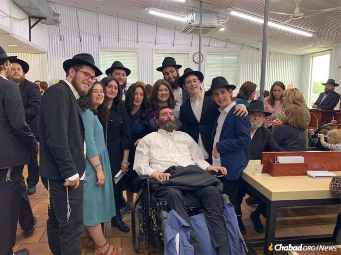 The Hurwitz family at the Ohel. (Photo: Levi Liberow)