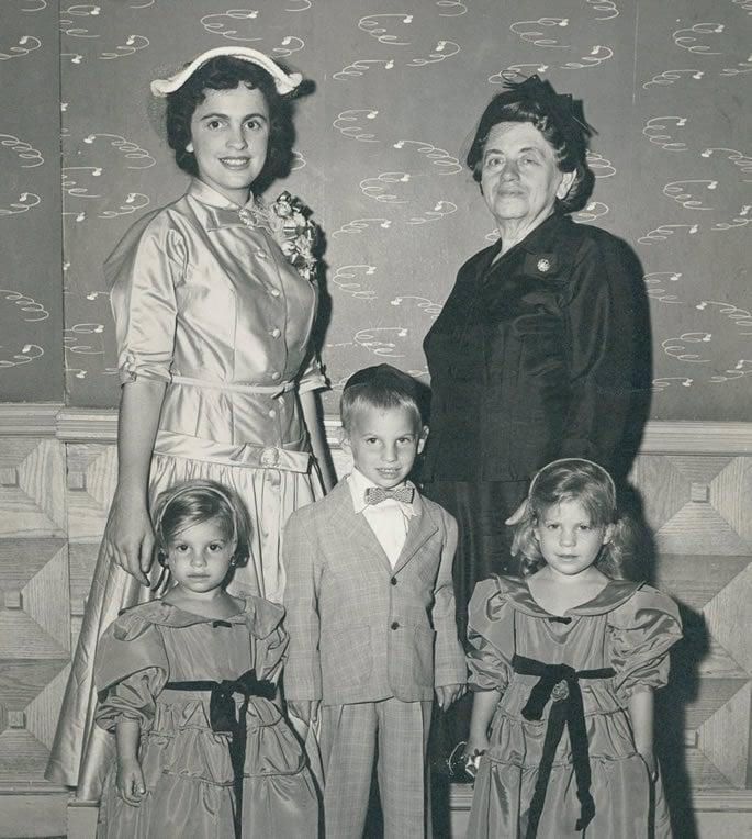 Sara (left) with her mother-in-law, Mrs. Gitel Feigelstock, and her children, Yossi, Shterna Greisman (right), Rivkah Teitelbaum (left).