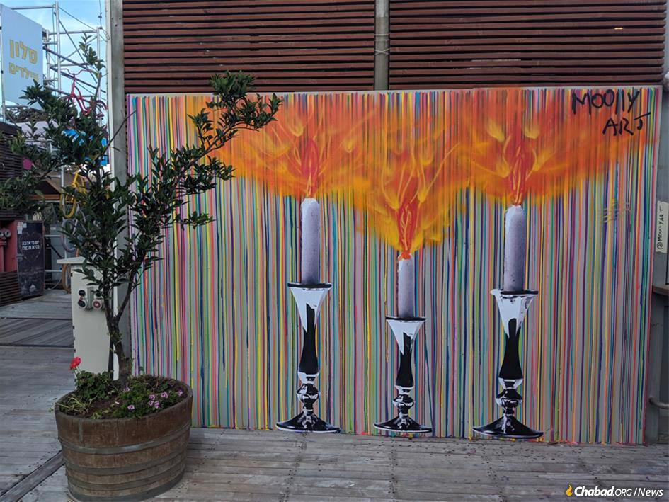 """""""Spread Your Light–To The Street,"""" by artist Yitzchok Moully is featured at Jerusalem's First Station as part of the Fourth Jerusalem Biennale, an art exhibition held once every two years."""