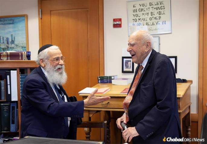 Weinstein and Rabbi Sholom Lipskar, founder of the Aleph Institute, the leading Jewish organization caring for the incarcerated and their families, share a laugh in Weinstein's chambers at the federal courthouse in Brooklyn in June of 2019. (Photo: Moshe Finkelstein/Chabad.org)