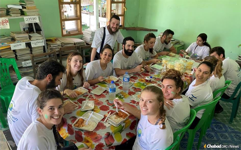 Rabbi Schneur Raitport hosts a group of visitors from Israel at the new Chabad center in Yangon, Myanmar.