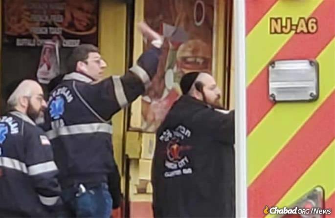 Hatzalah emergency service responders work at the scene of the shooting.