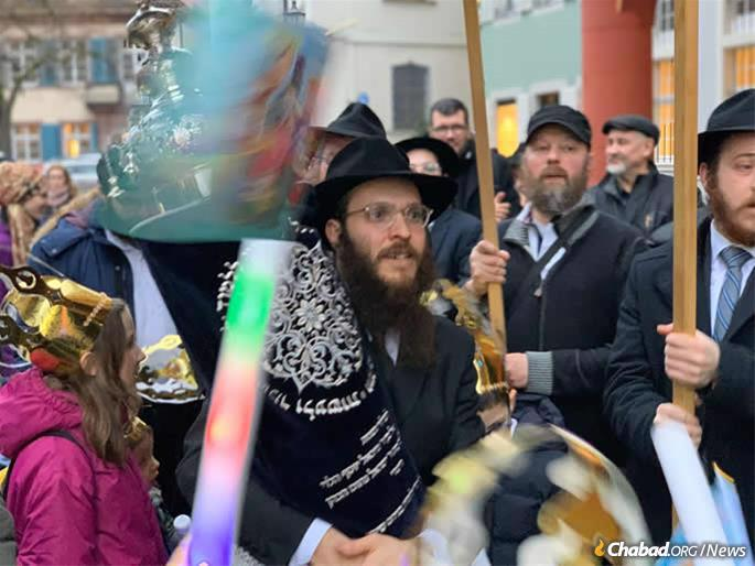 Rabbi Yakov Gitler, who co-directs the Freiburg Chabad center with his wife, Chava, dances with the Torah.