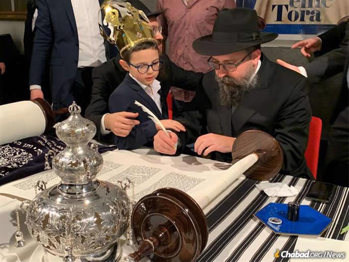 The Torah was brought from Israel by the Chabad Terror Victims Project and its director, Rabbi Menachem Kutner, above. It was sponsored by an anonymous donor with some of the letters filled in by family members of terror victims over a 14-year period.