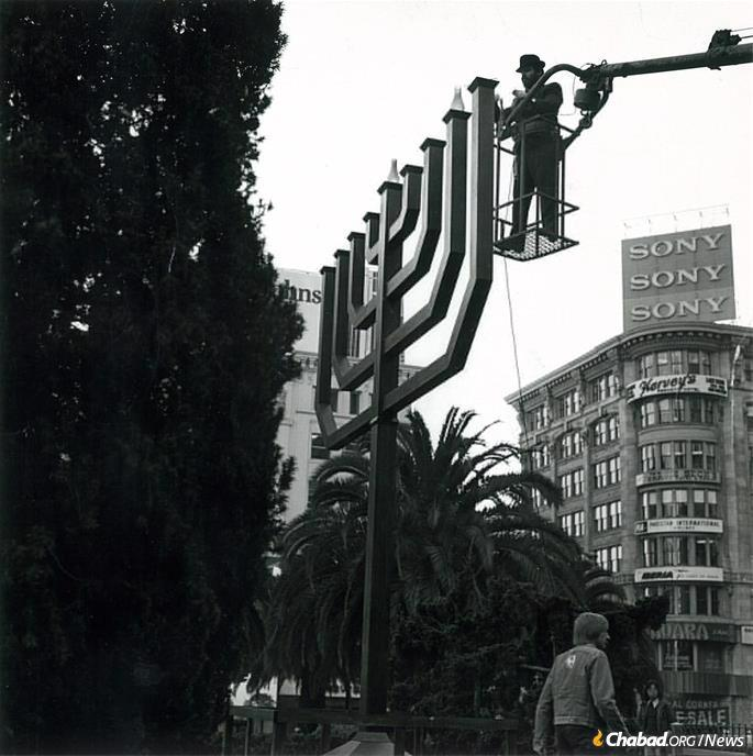 Rabbi Chaim Drizin lights the giant mahogany menorah in Union Square. (Photo: Rabbi Chaim Drizin)