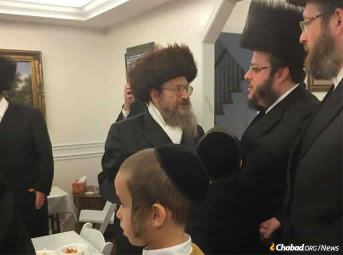 Rabbi Yosef Neumann surrounded by his beloved community.