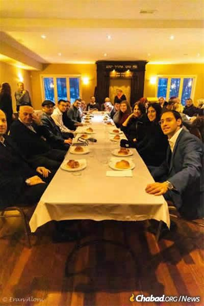 Passengers stranded in Halifax, Nova Scotia, sit down for a festive meal before the onset of the Jewish Sabbath. (Photo: Eran Aloni)
