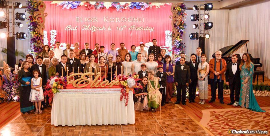 Cambodia's royal family turned out in Phnom Penh for Elior Koroghli's bat mitzvah party. She is standing in ninth from right, wearing a white dress, behind her younger brothers. (Photo: Kang Predi/Teh Ranie)