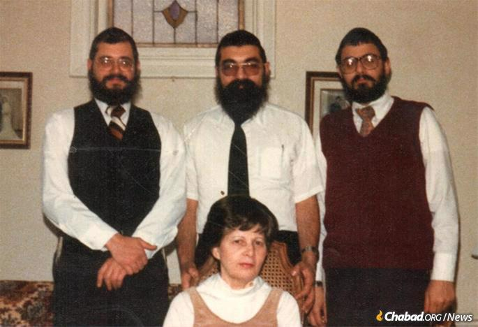 Sonia Kaplan flanked by her sons: Rabbis Nochem, Leibel and Shmuel Kaplan
